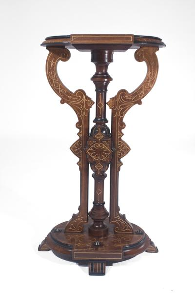 AMERICAN PEDESTAL Walnut, parcel gilt with ebonizi...