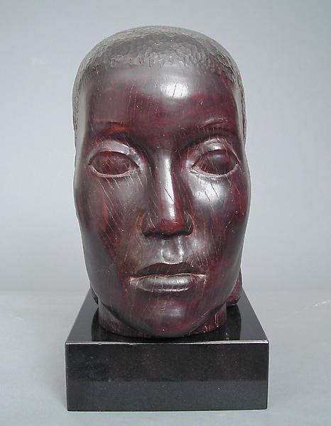 HEAD, c. 1935-43 Lignum vitae on marble base 14 x...