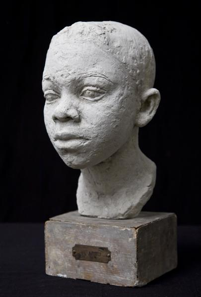 HEAD OF A BOY, c. 1930-35 Terracotta on original w...