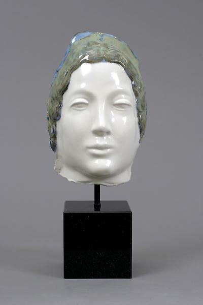 MASK OF FANCY, c. 1923-25 Glazed terra cotta mask...