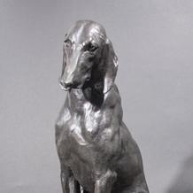 PAIR OF SEATED HOUNDS